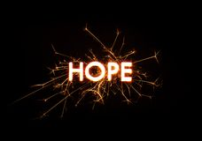 HOPE title word in glowing sparkler Stock Photos