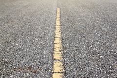 Yellow line on asphalt road. royalty free stock image