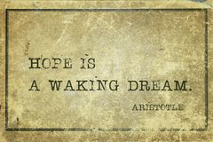 Waking dream Aristotle. Hope is a waking dream - ancient Greek philosopher Aristotle quote printed on grunge vintage cardboard Royalty Free Stock Photo