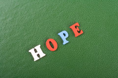 HOPE word on green background composed from colorful abc alphabet block wooden letters, copy space for ad text. Learning Royalty Free Stock Photo