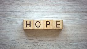 Hope word made of cubes, pure and genuine belief in god, prayers and blessings. Stock photo royalty free stock photography