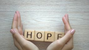 Hope word made by female hands, family creation, expectancy of baby, happiness. Stock footage stock footage