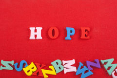 HOPE word on red background composed from colorful abc alphabet block wooden letters, copy space for ad text. Learning. English concept stock images