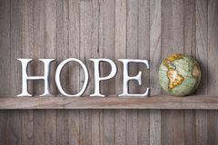 Hope World Globe Wooden Background. A rustic wood background with the word hope on it with a world globe Royalty Free Stock Images