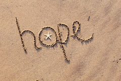 Hope written in Sand. Close up  of word 'hope' written in sand at beach Royalty Free Stock Images