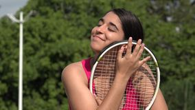 Hopeful Athletic Female Teenage Tennis Player. A young female hispanic teen stock video footage
