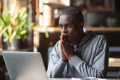 Free Hopeful Black Guy Hope For Best Reading News On Laptop Stock Image - 169417421