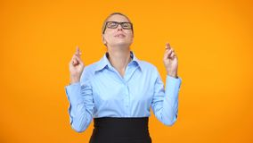 Hopeful business lady crossing fingers looking up, begging for career chance. Stock footage stock footage