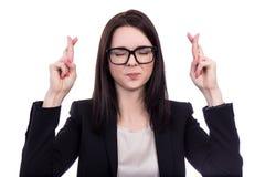 Hopeful business woman holding fingers crossed isolated on white Royalty Free Stock Image