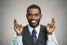 Hopeful businessman crossing his fingers Stock Image