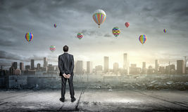 Hopeful businessman Stock Images