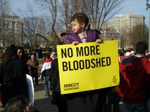 Hopeful Child. Photo of child protester at the white house in washington dc on 2/26/11 holding a poster protesting the brutality of a middle east leader.  This Stock Images