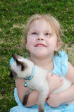 Hopeful child with kitten Stock Photos
