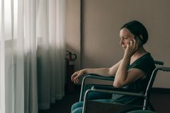 Free Hopeful Female Person With Disability Talking On Mobile Phone Royalty Free Stock Photography - 158069437