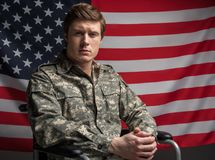 Hopeful handicapped veteran is proud of his country royalty free stock image