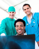 Hopeful male doctors looking at X-Ray. In hospital Royalty Free Stock Photography