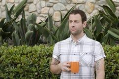 Hopeful man with a coffee mug. Royalty Free Stock Image