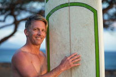 Hopeful Man with Surfboard Royalty Free Stock Photo