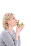 Hopeful woman kissing her frog. Hopeful woman kissing her ceramic frog in the hopes that it will turn into a dashing Prince charming Stock Images