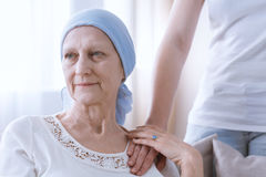 Hopeful woman battling with cancer Stock Photos