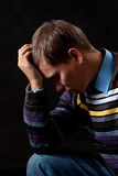 Hopeless. Young man thinking about something in the dark Stock Photo