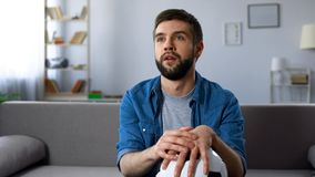 Hopeless fan disappointed at bad game of national football team, competition stock photography