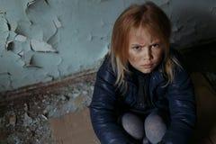 Hopeless girl sitting on the floor Stock Image