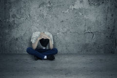 Hopeless Man. Young man hopeless sitting alone on the floor Stock Images