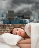 Hopeless and sad. Hopeless sad woman sleeping on the roof of a building Stock Photography