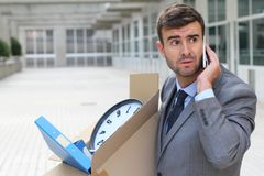 Hopeless unemployed businessman carrying his belongings.  Royalty Free Stock Photo