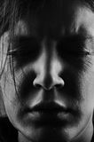 Hopeless woman face. Detail of a hopeless woman face Royalty Free Stock Photography