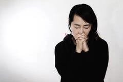 Hopeless woman praying Stock Photo