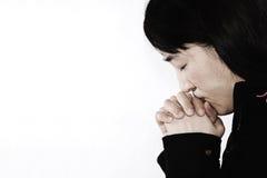 Hopeless woman praying Royalty Free Stock Images
