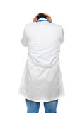 Hopeless young doctor turned. On white background Stock Image