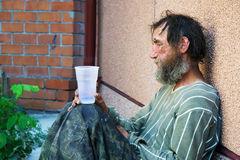 Hopelessness. Homeless poor alcoholic in depression Royalty Free Stock Photography