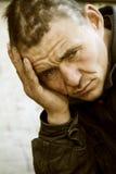 Hopelessness. One more hard day of a homeless beggar Stock Image