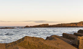 Hopeman's Daisy Rock Sundown. This is the view across the rocks of Hopeman's Beach just before sunset to the rock named Daisy, Moray, Scotland, United Kingdom Royalty Free Stock Photo
