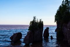 Hopewell Rocks in the Evening Receding Tide stock images