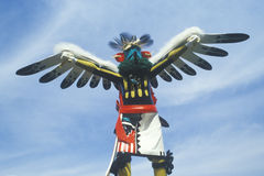 Hopi Kachina doll with outstretched winged arms against blue sky Stock Image