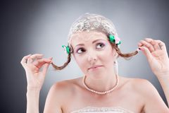 Hoping cute beautiful young bride holding her hair Royalty Free Stock Photography