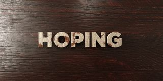Hoping - grungy wooden headline on Maple  - 3D rendered royalty free stock image. This image can be used for an online website banner ad or a print postcard Royalty Free Stock Photos