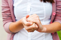 Hoping for help. Woman crossed her fingers together Royalty Free Stock Photo