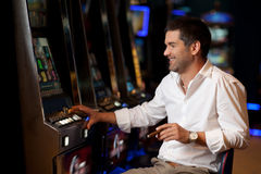 Hoping to win casino player Royalty Free Stock Photos