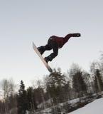 Hopp på en snowboard Arkivbild