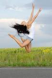 Hoppa för Ballerina som är högt i luften Fotografering för Bildbyråer