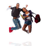 Hoppa för två lyckligt studenter av lycka Royaltyfri Bild