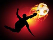 Hoppa sparka brandbollen i luften Royaltyfria Foton