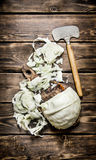Hopped cabbage with an old hatchet . Royalty Free Stock Photos