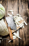 Hopped cabbage with an old hatchet . Royalty Free Stock Photo