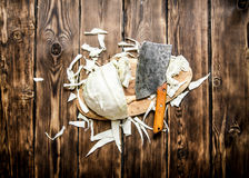 Hopped cabbage with an old hatchet . Royalty Free Stock Image